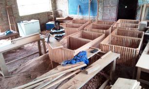 Les clapiers des lapins construits à la menuiserie de PAwa