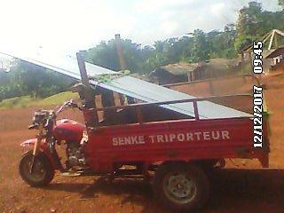 Transport des tôles par triporteur